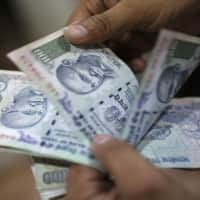 Rupee hits near 1-1/2 year high; bonds rally, shares fall