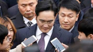 Jay Y. Lee arrives at prosecutor's office before arrest hearing