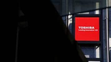 S&P downgrade warning sends Toshiba shares falling