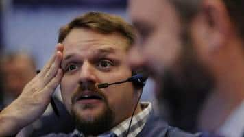 Wall Street edges higher to give Dow 11th straight record