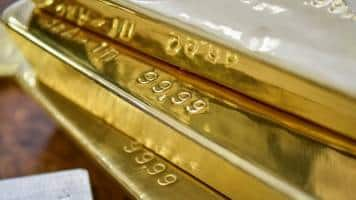 Gold steady near lowest in over 4 weeks, rate hike outlook drags