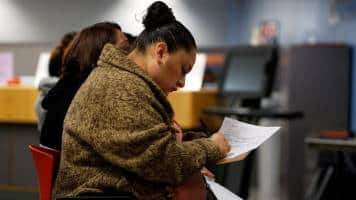 US job growth seen strong in February; wages to rebound