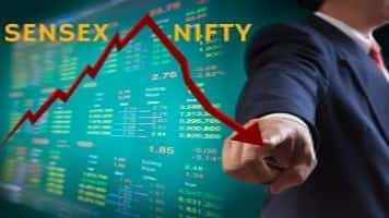 Sensex, Nifty snap 4-day gains on caution ahead of RBI policy