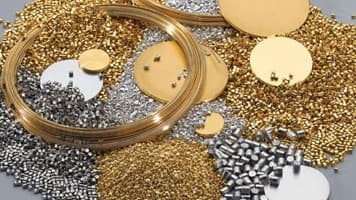 Gold falls off 30-month high on low demand; weak global cues