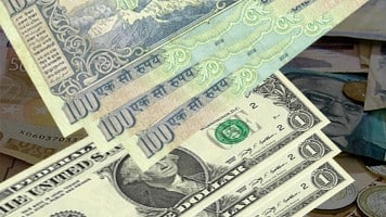 Rupee trims initial gains, still up by 2 paise vs dollar