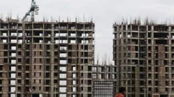 'GIC front runner to buy 49% in 3 DLF residential projects'