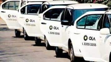 Automaker Mahindra partners ride-sharing firm Ola