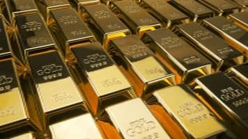 Gold futures gain Rs 77 on global cues