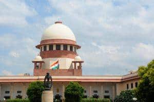 Give flat to union minister Rathore in two days: SC to Parsvnath